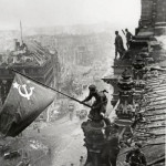 SOVIET SOLDIERS RAISING A RED FLAG OVER THE REICHSTAG, BERLIN, 1945
