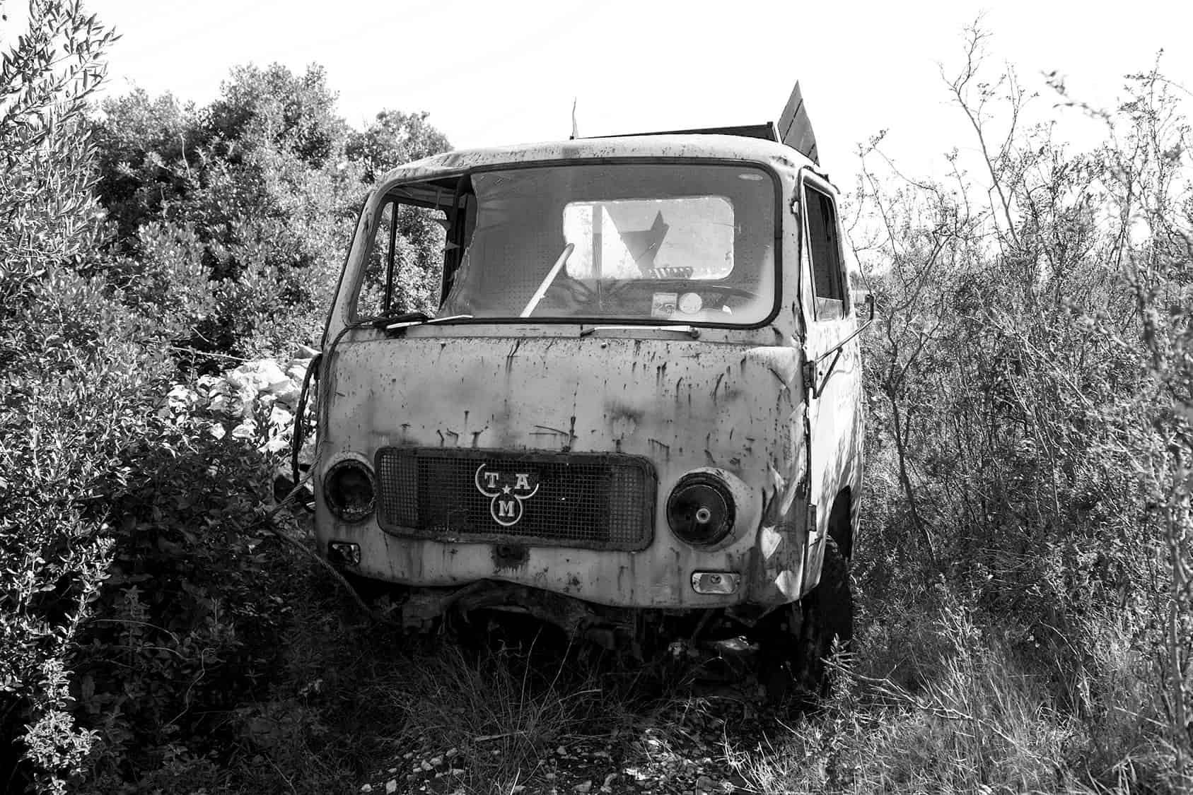 Derelict and abandoned vehicles with smashed windscreen and headlights